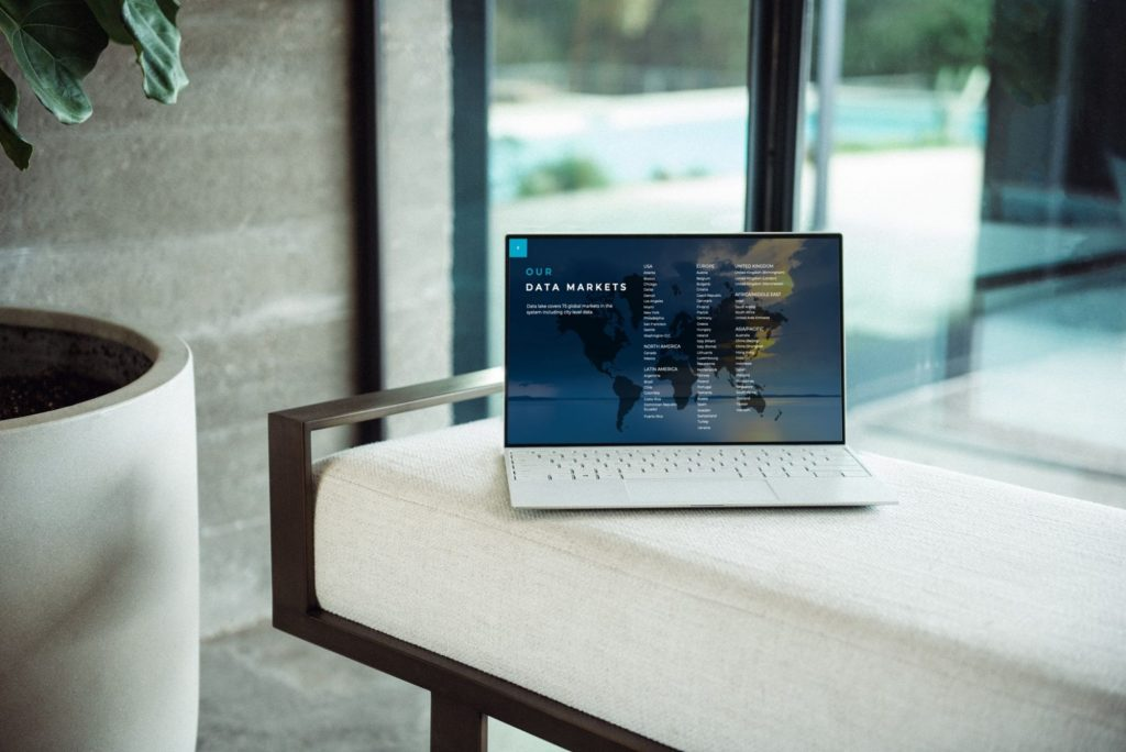 RightSpend data from 75 global markets listed on a laptop